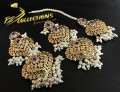 GOLDEN BASED HYDERABADI DESIGN EARRING ALONG WITH MATCHING TEEKA