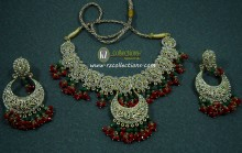 TRADITIONAL LOOK POLKIE STONES GOLDEN BASED WITH HANGING BEATS NECKLACE SET