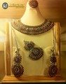 BASED ON ANTIQUE AND GOLDEN STUDDED STONE BRIDAL SET