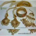 HYDERABADI DESIGN WITH GOLDEN BASED JHOOMER, EARRING ALONG WITH MATCHING BANGLE