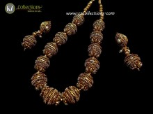 TRADITIONAL LOOK GOLDEN BASED INDIAN BALL MALA NECKLACE SET