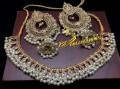 TRADITIONAL LOOK POLKI STONES GOLDEN BASED JHUMKI NECKLACE SET