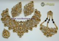 STYLISH GOLDEN BASED ZIRCON WITH SEMI STONES COMPLETE BRIDAL SET