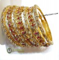 DECENT LOOK GOLD PLATED WITH SEMI PRECIOUS STONES 7 PIECES SETS BANGLE