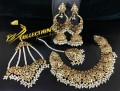 GOLDEN BASED HYDERABADI DESIGN WITH SEMI PRECIOUS STONES COMPLETE BRIDAL SET
