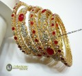 BEAUTIFUL DESIGN GOLDEN BASED 9 PIECES BANGLE