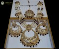 STYLISH GOLDEN BASED WITH 4 STEPS LAYERS WITH HANGING BIG BUNCH NECKLACE SET