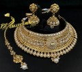 TRADITIONAL LOOK GOLDEN BASED ZIRCON STONES INDIAN BRIDAL SET